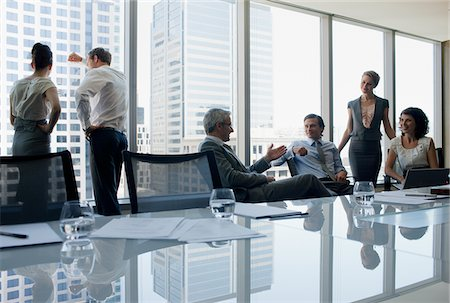 Business people working together in conference room Stock Photo - Premium Royalty-Free, Code: 635-03752829