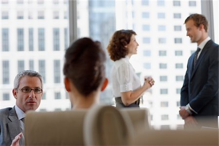 Business people working together in conference room Stock Photo - Premium Royalty-Free, Code: 635-03752822