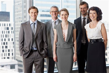 five people - Business people standing together in office Stock Photo - Premium Royalty-Free, Code: 635-03752832