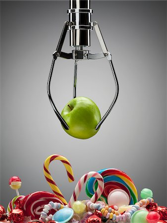 snack - Hook with green apple above variety of sweet candies Stock Photo - Premium Royalty-Free, Code: 635-03752888