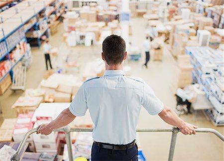 supervising - Supervisor  monitoring shipping work Stock Photo - Premium Royalty-Free, Code: 635-03781317