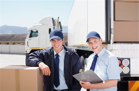 side view tractor trailer truck - Workers standing with boxes near semi-truck Stock Photo - Premium Royalty-Free, Code: 635-03781366