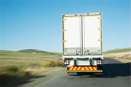rear - Semi-truck driving on remote rode Stock Photo - Premium Royalty-Free, Code: 635-03781398