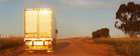 rear - Semi-truck driving on dirt road Stock Photo - Premium Royalty-Free, Code: 635-03781426