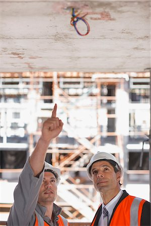 supervising - Construction workers looking at ceiling on construction site Stock Photo - Premium Royalty-Free, Code: 635-03781442