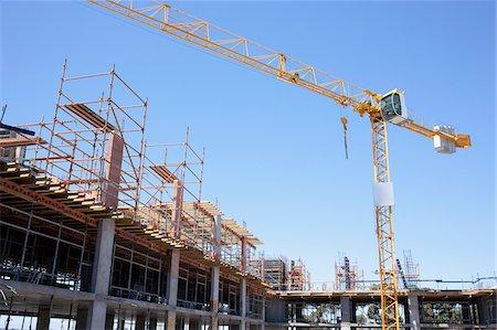 Crane on construction site Stock Photo - Premium Royalty-Free, Code: 635-03781456