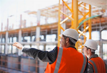 supervising - Construction workers working on construction site Stock Photo - Premium Royalty-Free, Code: 635-03781486