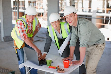 drawing computer - Construction workers working together on construction site Stock Photo - Premium Royalty-Free, Code: 635-03781487