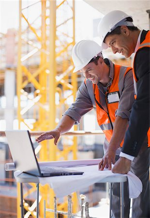 supervising - Construction workers using laptop on construction site Stock Photo - Premium Royalty-Free, Code: 635-03781506