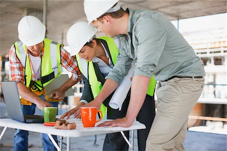 drawing computer - Construction workers looking at papers on construction site Stock Photo - Premium Royalty-Free, Code: 635-03781503