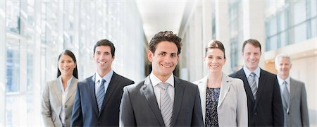 Business people standing together in office Stock Photo - Premium Royalty-Free, Code: 635-03781517