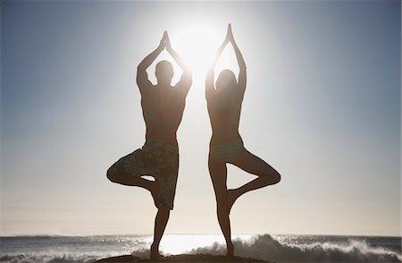 Couple practicing yoga on beach Stock Photo - Premium Royalty-Free, Code: 635-03781658