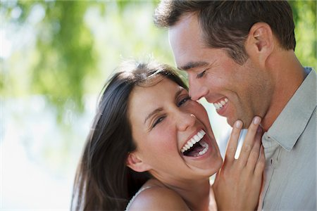 Happy couple laughing together Stock Photo - Premium Royalty-Free, Code: 635-03781666