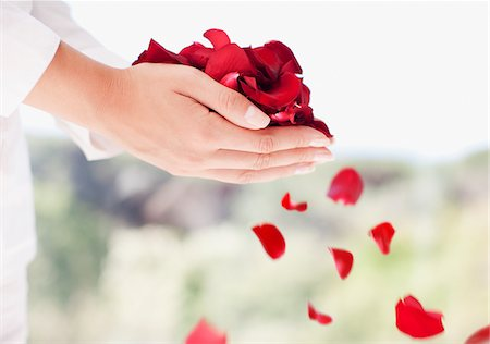 people falling - Woman holding handful of flower petals Stock Photo - Premium Royalty-Free, Code: 635-03781670