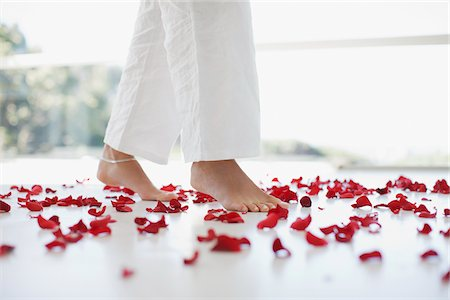 floral - Woman walking through flower petals on floor Stock Photo - Premium Royalty-Free, Code: 635-03781684