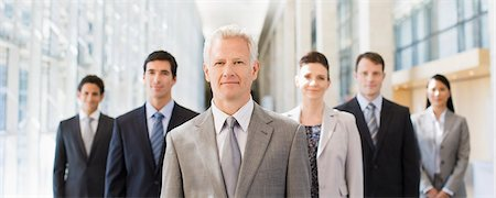 Business people standing together in office Stock Photo - Premium Royalty-Free, Code: 635-03781789