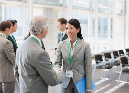 Business people shaking hands at seminar Stock Photo - Premium Royalty-Free, Code: 635-03781805