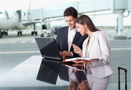 planner - Business people using laptop together at airport Stock Photo - Premium Royalty-Free, Code: 635-03781800
