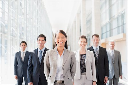 Business people standing together in office Stock Photo - Premium Royalty-Free, Code: 635-03781802