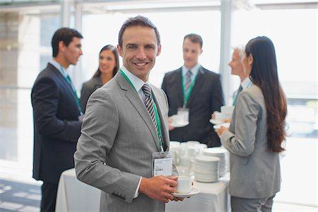 Business people having coffee break in office Stock Photo - Premium Royalty-Free, Code: 635-03781803