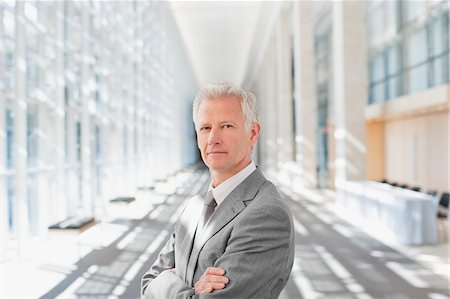 superior - Businessman standing with arms crossed in office Stock Photo - Premium Royalty-Free, Code: 635-03781814