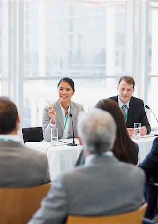 Business woman talking on panel at seminar Stock Photo - Premium Royalty-Free, Code: 635-03781819
