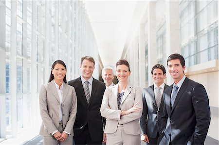 Business people standing in office Stock Photo - Premium Royalty-Free, Code: 635-03781821