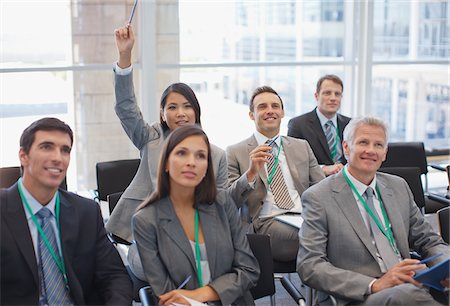 Business people attending seminar in office Stock Photo - Premium Royalty-Free, Code: 635-03781834