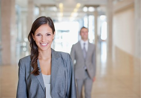 Businesswoman standing in office Stock Photo - Premium Royalty-Free, Code: 635-03781844