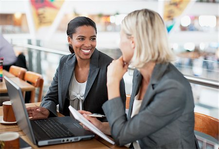 Businesswoman working together in cafe Stock Photo - Premium Royalty-Free, Code: 635-03781849