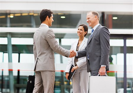 Businessmen shaking hands outdoors Stock Photo - Premium Royalty-Free, Code: 635-03781850