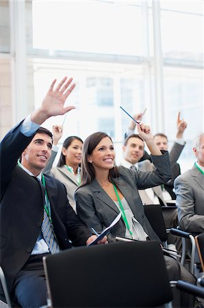 Business people attending seminar in office Stock Photo - Premium Royalty-Free, Code: 635-03781867