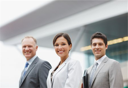 Business people standing together in office Stock Photo - Premium Royalty-Free, Code: 635-03781862