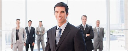 Business people standing together in office Stock Photo - Premium Royalty-Free, Code: 635-03781879
