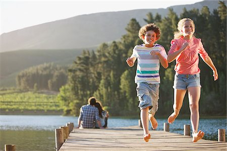 Kids running on dock Stock Photo - Premium Royalty-Free, Code: 635-03859679