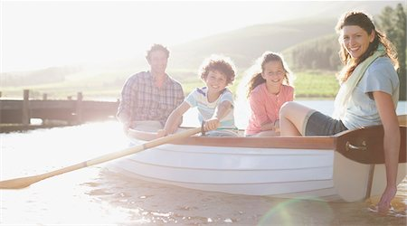 side view of person rowing in boat - Family in rowboat on lake Stock Photo - Premium Royalty-Free, Code: 635-03859672