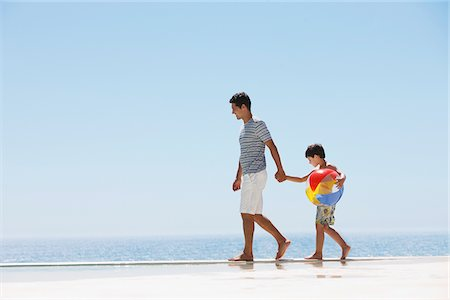 forever - Father and son walking along infinity pool Stock Photo - Premium Royalty-Free, Code: 635-03859700