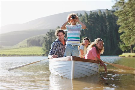 side view of person rowing in boat - Family in rowboat on lake Stock Photo - Premium Royalty-Free, Code: 635-03859703
