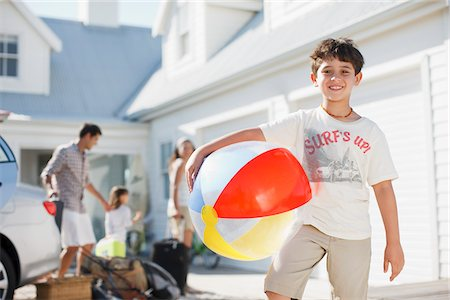 Boy with beach ball in driveway Stock Photo - Premium Royalty-Free, Code: 635-03859769