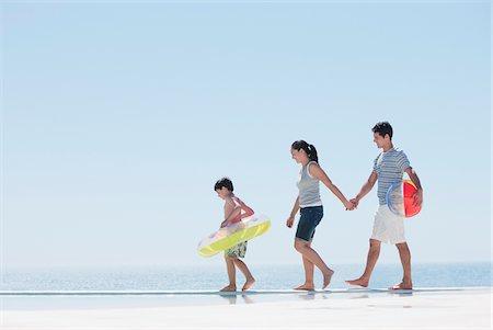 forever - Family walking along infinity pool Stock Photo - Premium Royalty-Free, Code: 635-03859790