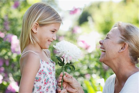 selecting - Grandmother giving flower to granddaughter in garden Stock Photo - Premium Royalty-Free, Code: 635-03859867