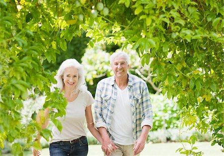 Senior couple walking in garden Stock Photo - Premium Royalty-Free, Code: 635-03859909