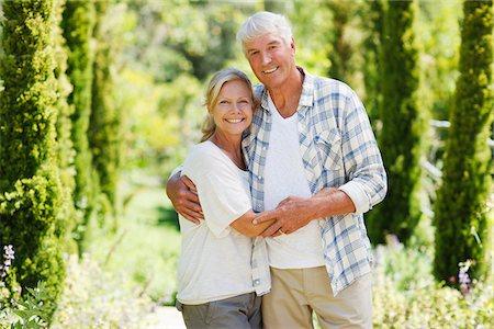 Senior couple smiling in garden Stock Photo - Premium Royalty-Free, Code: 635-03859948
