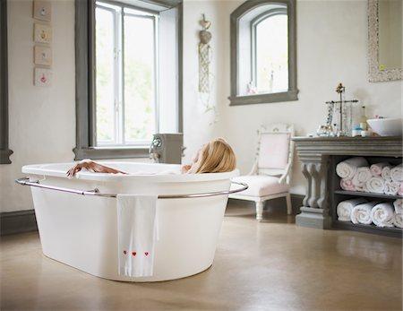 Woman in bathtub Stock Photo - Premium Royalty-Free, Code: 635-03859941