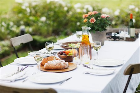 Food on table in garden Stock Photo - Premium Royalty-Free, Code: 635-03859943