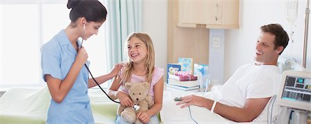 Nurse with father and daughter in hospital Stock Photo - Premium Royalty-Free, Code: 635-03859969