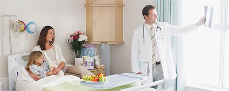 Pediatrician showing patient and mother x-ray in hospital Stock Photo - Premium Royalty-Free, Code: 635-03859994