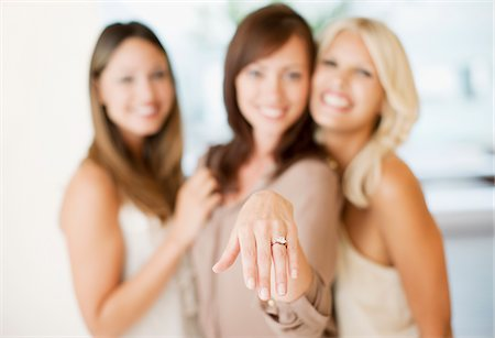 Woman showing engagement ring Stock Photo - Premium Royalty-Free, Code: 635-03860054