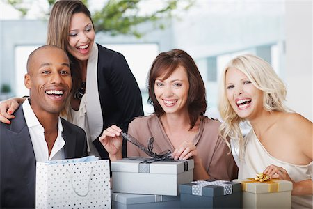 Friends opening gifts Stock Photo - Premium Royalty-Free, Code: 635-03860067