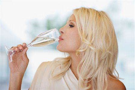sparkling - Woman drinking champagne Stock Photo - Premium Royalty-Free, Code: 635-03860091